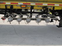 bottom load heads with vapor recovery on used tanker trailer